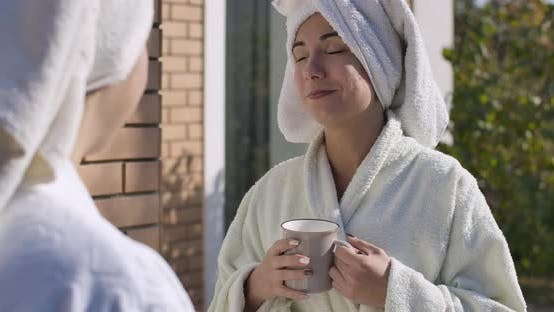 Thumbnail for Portrait of Young Lady in Bathrobe and Hair Towel Standing Outdoors And, Looking at Camera