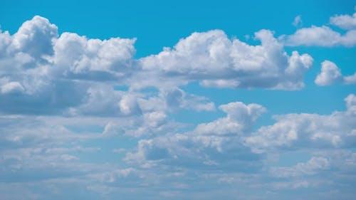Cumulus Cirrus Clouds Move in the Blue Sky. Time Lapse