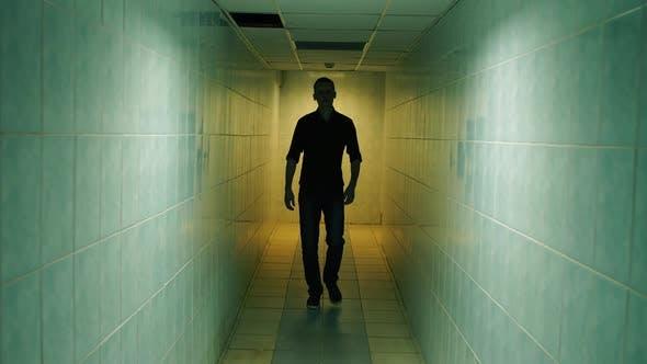 Thumbnail for Man Walk Down a Corridor