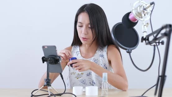 Thumbnail for Young Woman having live stream on mobile phone