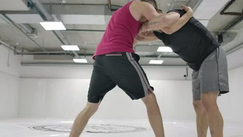 The Wrestler Moves to the Opponent Grabs and Rolls with Finishing on the Mats in Slow Motion