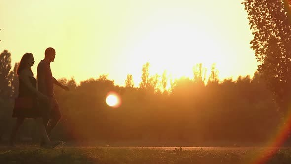Thumbnail for Happy Couple Spending Weekend Together, Walking by Hand in Golden Sunset Rays