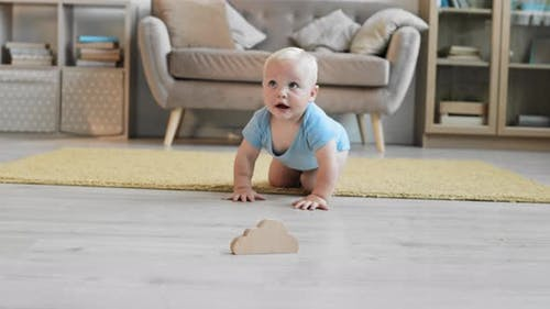 Cheerful Toddler Playing and Crawling