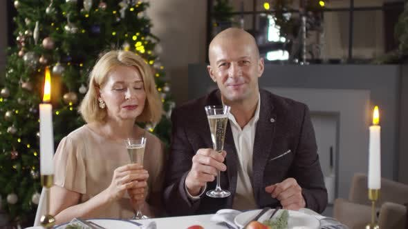 Thumbnail for Middle-Aged Couple Wishing Happy New Year on Video Call