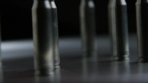 Cinematic rotating shot of bullets on a metallic surface - BULLETS 019