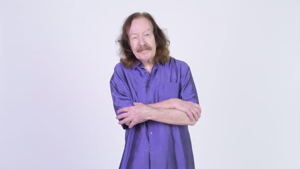 Thumbnail for Happy Senior Man Wearing Purple Silky Shirt with Arms Crossed