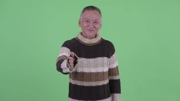 Thumbnail for Happy Mature Japanese Man Giving Handshake Ready for Winter