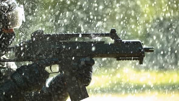 Thumbnail for Gun in the rain, slow motion
