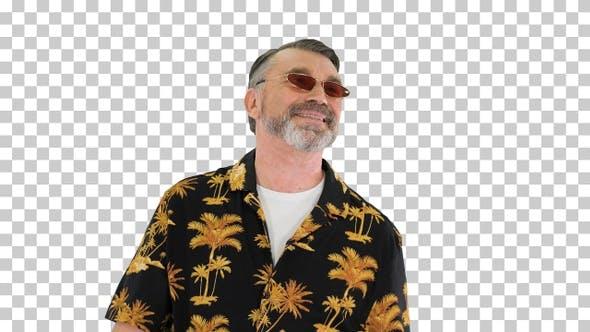 Senior man tourist in sunglasses walking, Alpha Channel