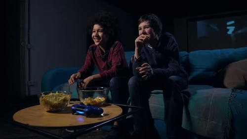 Laughing Boys Eating Popcorn and Watching Comedy