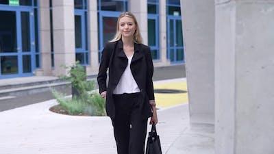 Confident Businesswoman Walking on Street
