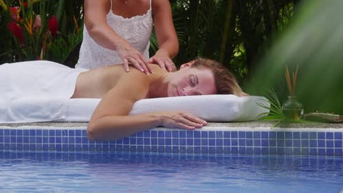 Woman gets back massage at spa, Costa Rica. Shot on RED EPIC for high quality 4K, UHD, Ultra HD reso