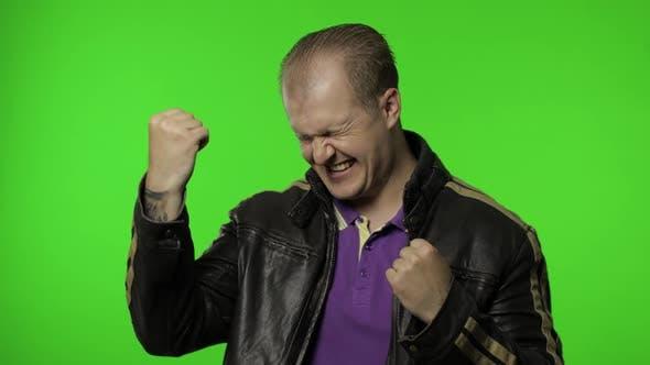 Crazy Overjoyed Rocker Man on Chroma Key Raising Fists Gesturing Yes Success, Celebrating Triumph