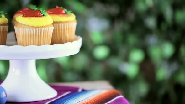 Cupcakes decorated with red chili peppers for Cinco de Mayo