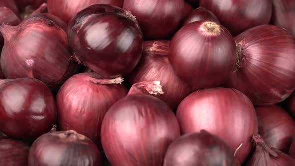 Cover Image for Rotating Red Onions Background