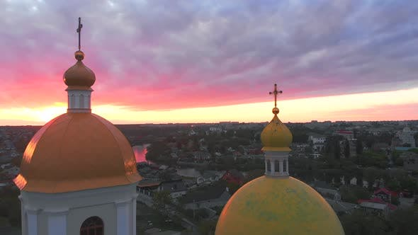 Small Church at the Bright Cloudy Sunset Filmed By Drone in Small European City. Kyiv Region