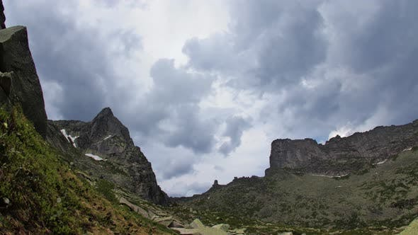 Thumbnail for Clouds Above Mountain Peaks