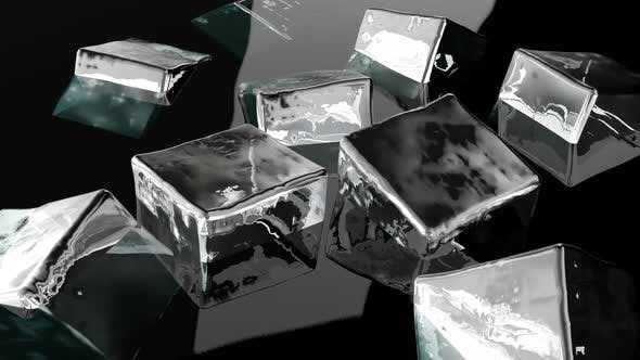 Ice Cubes Float in a Transparent Alcohol
