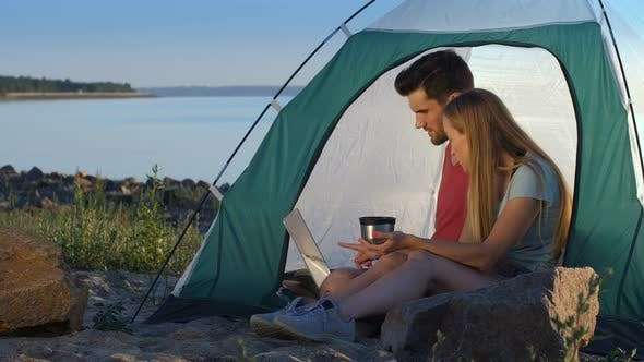 Thumbnail for Relaxed Couple of Travelers Camping at Seaside