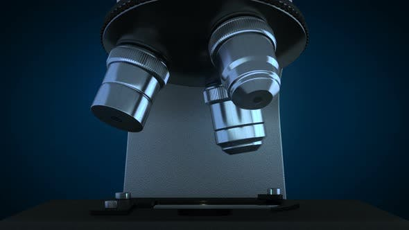 Cover Image for Scientific Microscope in Dark Laboratory Rotating its Metal Lenses