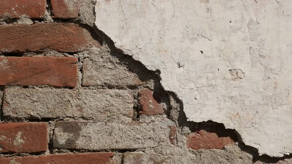 Thumbnail for Destructed  wall white cement plaster 4K 2160p 30fps UltraHD footage - Old  brick  building facade