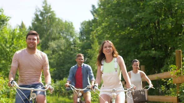 Thumbnail for Happy Friends Riding Fixed Gear Bicycles in Summer