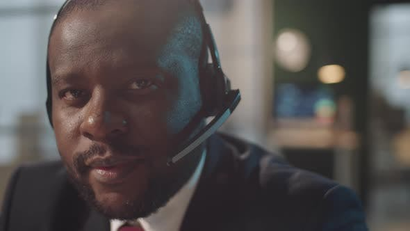 Thumbnail for Portrait of Smiling Afro-American Businessman in Headset