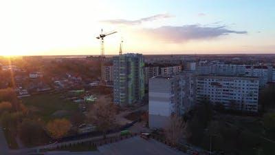 Construction Crane House At Sunset