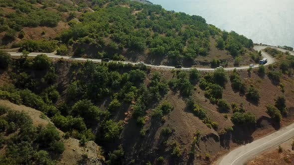 Thumbnail for Drones Eye View - Winding Road From the High Mountain Pass To Crimea. Great Road Trip
