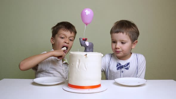 Thumbnail for A red banded birthday cake. Pastry shop advertisment. Children eating birthday cake