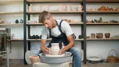 Pottery Workshop Man Ceramist Makes a Pitcher Out of Clay Handicraft Production of Handmade