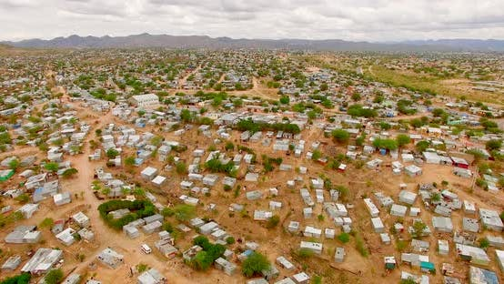 Thumbnail for Rural Landscape Covered with Shacks and Containers.  Drone Shot of Poor and Overcrowded Urban