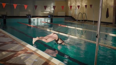A Slender Brunette is Jumping Into the Pool