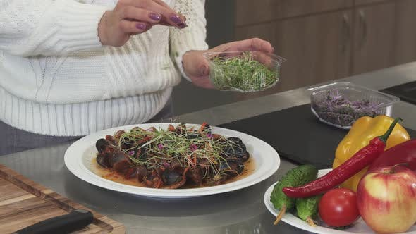 Thumbnail for Cropped Clsoe Up of a Woman Garnishing Delicious Dish with Greens Cooking at Home
