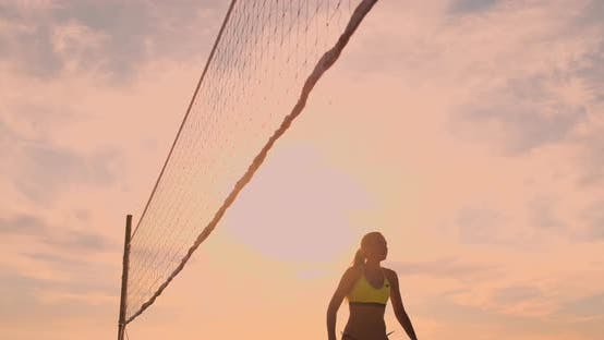 Thumbnail for Beach Volleyball Match Girls Hit the Ball in Slow Motion at Sunset on the Sand.