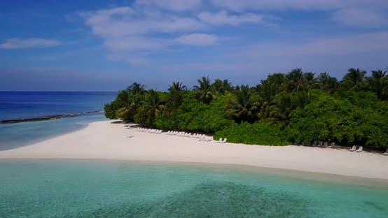 Thumbnail for Beautiful fly over clean view of a sunshine white sandy paradise beach and aqua blue water backgroun