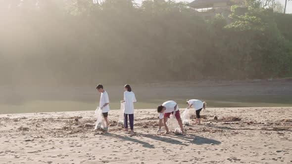 Volunteers Collecting Rubbish On Coast