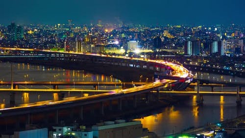 time lapse of highway road bridge with Arakawa river in Tokyo at night, Japan