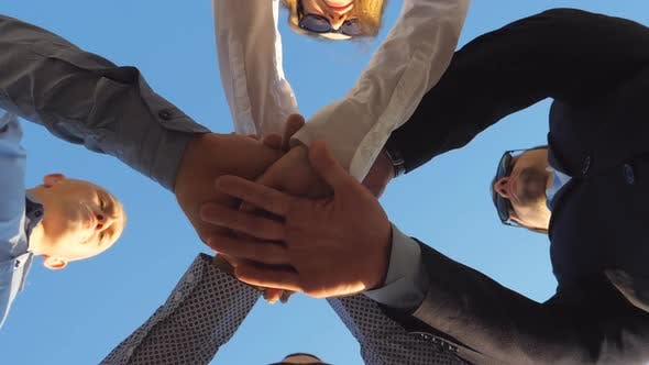 Thumbnail for Group of Young Businessman Stand in a Circle and Puts Their Hands Together. Business People