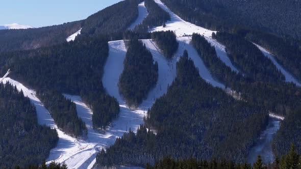Thumbnail for Snowy Slopes at a Ski Resort in Sunny Day. Skiers Going To the Mountains