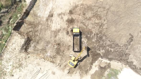 Thumbnail for Construction Work with the Help of Trucks and Excavators