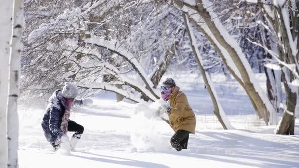 Thumbnail for Happy Stylish Couple Playing with Snow at Sunny Winter Day. Winter, Sport, Holidays, Relationship