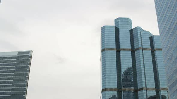 Thumbnail for Close-Up Glass Skyscrapers at Daylight, Sky Reflection at Facades Corporate Buildings