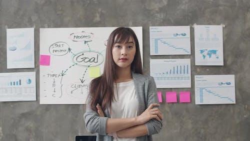 beautiful executive businesswoman smart casual wear looking at camera