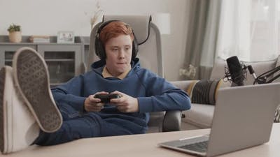 Boy Relaxing by Playing Computer Game
