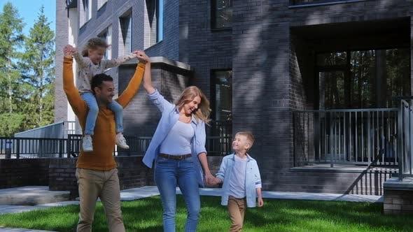Thumbnail for Family Walking at Summer Day at Backyard of House
