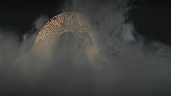 Skull Covered In Smoke On A Dark Background.