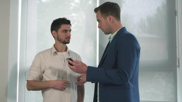 Thumbnail for Two Business Men Near the Windows Talking