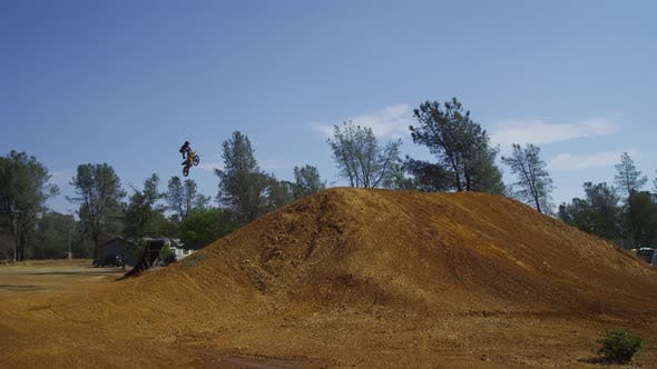 Thumbnail for Motocross rider going off big jump, slow motion, 4K shot on RED Epic
