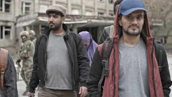 Thumbnail for Arab Refugees Walking in Camp